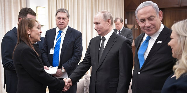 Russian President Vladimir Putin, center, shakes hands with Yaffa Issachar, mother of Israeli citizen Naama Issachar, who is jailed in Russia for drug trafficking, during the meeting with Israeli Prime Minister Benjamin Netanyahu, 2nd right, in Tel-Aviv, Israel, Thursday, Jan. 23, 2020.