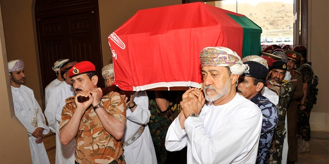 In this photo made available by Oman News Agency, Oman's new sultan Haitham bin Tariq Al Said, right, carries the Sultan Qaboos' coffin at Sultan Qaboos Grand Mosque in Muscat, Oman, Saturday, Jan. 11, 2020. Sultan Qaboos bin Said, the Mideast's longest-ruling monarch who seized power in a 1970 palace coup and pulled his Arabian sultanate into modernity while carefully balancing diplomatic ties between adversaries Iran and the U.S., has died. He was 79. (Oman News Agency via AP)