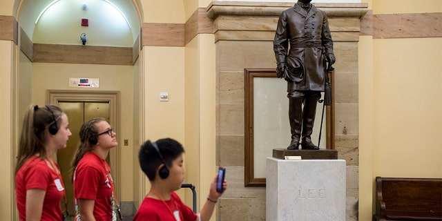 Virginia's statue of Confederate general Robert E. Lee stands in the Crypt in the U.S. Capitol. (Photo By Bill Clark/CQ Roll Call)