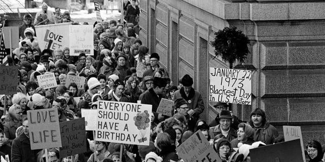 """An estimated 5,000 people, women and men, march around the Minnesota Capitol building protesting the U.S. Supreme Court's Roe v. Wade decision, ruling against state laws that criminalize abortion, in St. Paul, Minn., Jan. 22, 1973. The marchers formed a """"ring of life"""" around the building. (AP Photo)"""
