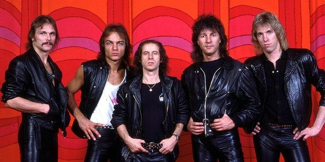 (L-R) German guitarist and founder of the hard rock band Scorpions, Rudolf Schenker, German bass guitarist Francis Buchholz, German vocalist, songwriter and instrumentalist Klaus Meine, German drummer Herman Rarebell, and German guitarist and songwriter Matthias Jabs, pose backstage at the Toledo Sports Arena during the Scorpion's Love At First Sting world tour, on June 27, 1984, in Toldeo, Ohio.