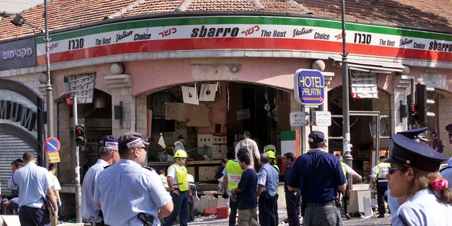 A gaping hole is left in the shop front of the Sbarro pizzeria after a suicide bombing that killed at least 18 people and wounded more than 80 others in Jerusalem on August 9, 2001. In the worst bombing in Jerusalem since the start of a Palestinian uprising last September, the suicide bomber blew himself up at the restaurant during the busy lunch hour. Six of the dead are children. NB/GB - RP2DRIDUUUAA