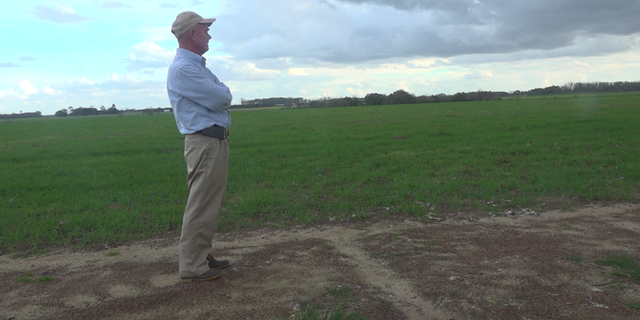 Farmer Murray Campbell stands on his farm, which pumps about 8-10 inches of water per acre in a growing season.