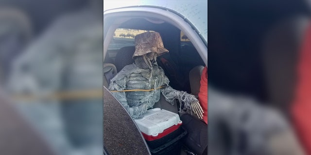 Arizona troopers ticketed a man in the HOV lane with a skeleton as his passenger.