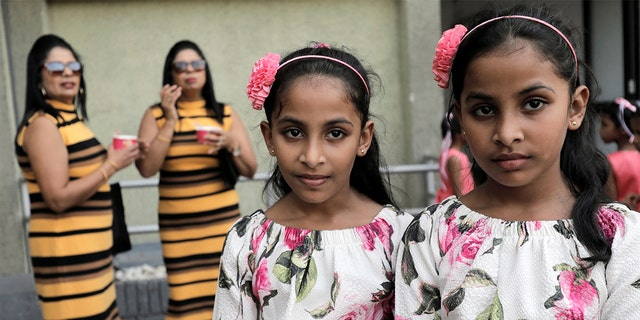 Twins pose for photographs during an event to attempt to break the world record for the biggest gathering of twins in Colombo, Sri Lanka.<br>