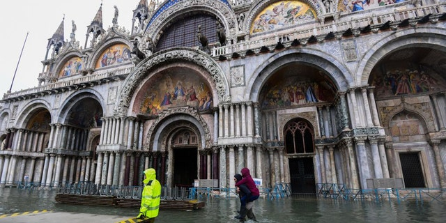 Footbridges were set up for pedestrians in Venice following the record flooding in November.