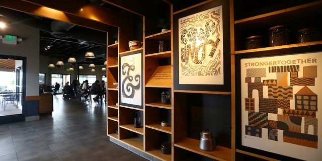 This Wednesday photo shows a Starbucks Community Store, which offers more space for patrons and a community meeting space, in Phoenix.  (AP Photo/Ross D. Franklin)