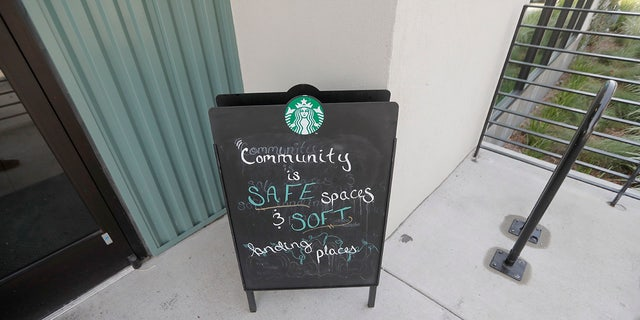 A sign at a Starbucks on South Claiborne Ave. in New Orleans reflects the community philosophy of the franchise, Thursday. (AP Photo/Gerald Herbert)