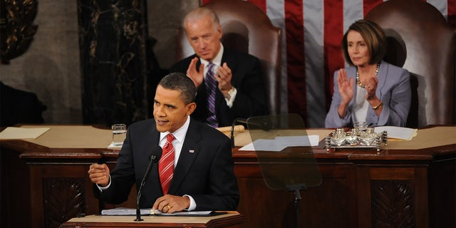 Vice President Joe Biden and House Speaker Nancy Pelosi sit behind President Barack Obama during his State of the Union address to a Joint Session of Congress on Capitol Hill on Jan. 27, 2010, in Washington, D.C. (Toni L. Sandys/The Washington Post via Getty Images)