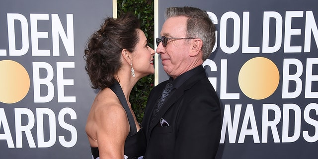 Jane Hajduk, left, and Tim Allen arrive at the 77th annual Golden Globe Awards at the Beverly Hilton Hotel on Sunday, Jan. 5, 2020, in Beverly Hills, Calif.