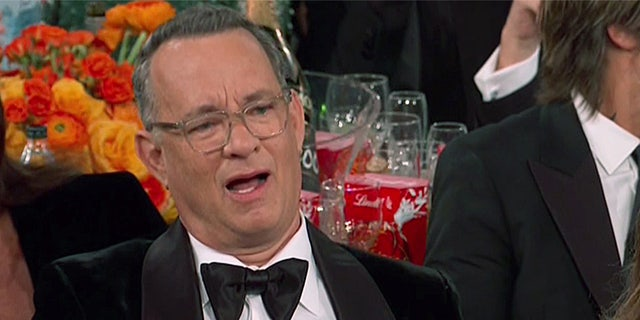 Tom Hanks' face went viral during the Golden Globes on Sunday night.