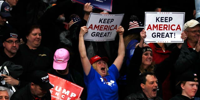 Supporters cheer as President Donald Trump speaks at a campaign rally, Thursday, Jan. 9, 2020, in Toledo, Ohio. (AP Photo/ Jacquelyn Martin)