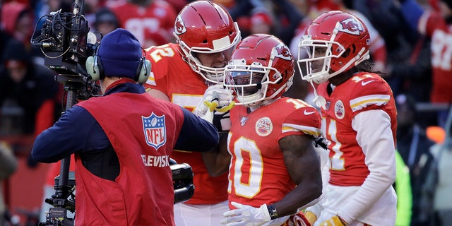 Kansas City Chiefs' Tyreek Hill (10) celebrating his touchdown catch during the first half of the AFC Championship game. (AP Photo/Charlie Riedel)