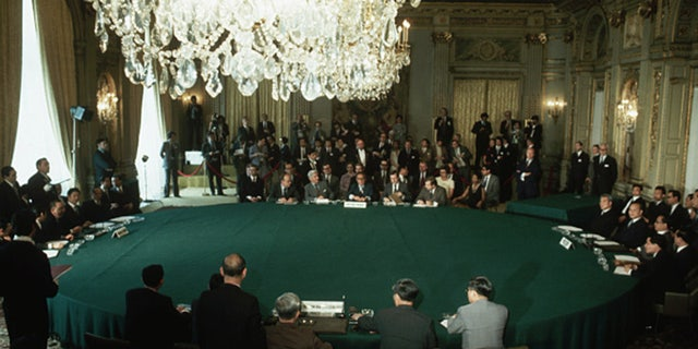 Representatives from the four factions of the Vietnam War meet in Paris to sign a peace agreement.