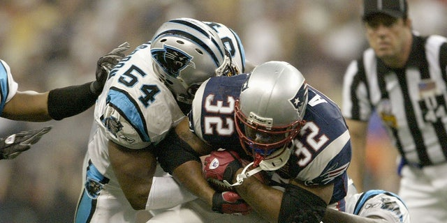 Will Witherspoon made several tackles in Super Bowl XXXVIII. (Photo by Elsa/Getty Images)