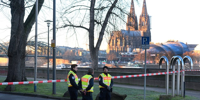 Employees of the public order office blocked a road close to the Cologne Cathedral on Tuesday as experts defused a World War II-era bomb. (Roberto Pfeil/dpa via AP)