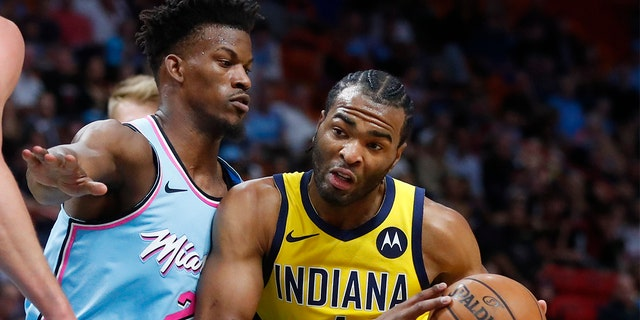 Indiana Pacers forward T.J. Warren (1) drives against Miami Heat forward Jimmy Butler (22) during the first half of an NBA basketball game Friday, Dec. 27, 2019, in Miami. (AP Photo/Wilfredo Lee)