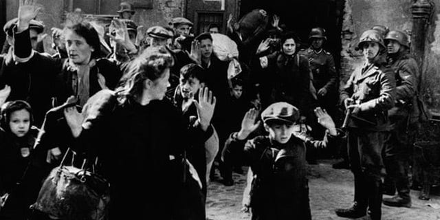 Frightened Jewish families surrender to Nazi soldiers at the Warsaw Ghetto in 1943. In January of that year, the residents of the ghetto rose against the Nazis and held their ground for several months, but were defeated after fierce fighting in April and May