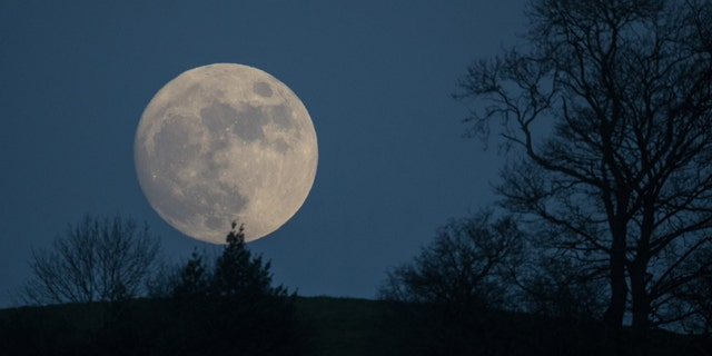 A so-called wolf Moon rises over Glastonbury Tor on January 11, 2017 in Somerset, England - file photo.