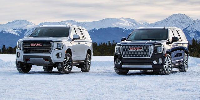 (L to R) 2021 GMC Yukon AT4 and Denali