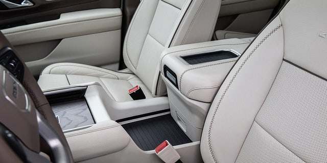 The power center console slides rearward to open up a deck between the seats.