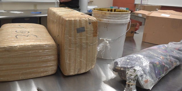 Maricopa County Sheriff's deputies recovered 25 gallons of crude oil marijuana and about 10,000 cartridges of vaping liquid from one operation east of Phoenix. (Stephanie Bennett/Fox News)