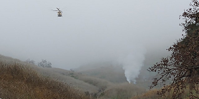 A helicopter crashed and sparked a small brush fire Sunday in Southern California, officials said.