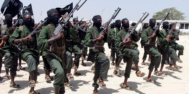 Hundreds of newly trained al-Shabab fighters perform military exercises near Mogadishu, in Somalia, in 2011.