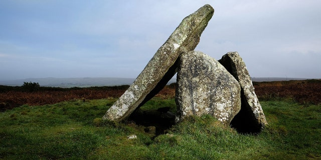 Graffiti which is thought to depict two alien figures has appeared on the ancient site of Mulfra Quoit in West Cornwalll. Vandals have caused fury by painting two ALIENS on stones at an ancient site. (Credit: SWNS)