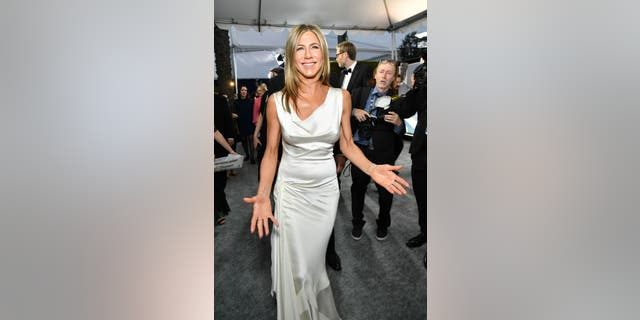Jennifer Aniston was all smiles as she made her way to the SAG awards red carpet.