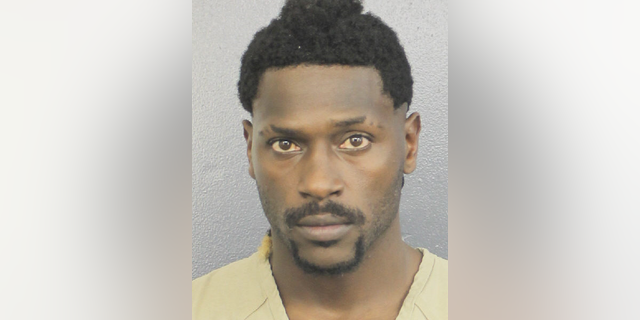 NFL free agent Antonio Brown turned himself in at a Florida jail on Thursday night, following accusations that he and his trainer attacked the driver of a moving truck that carried some of his possessions from California. (Broward Sheriff's Office via AP)