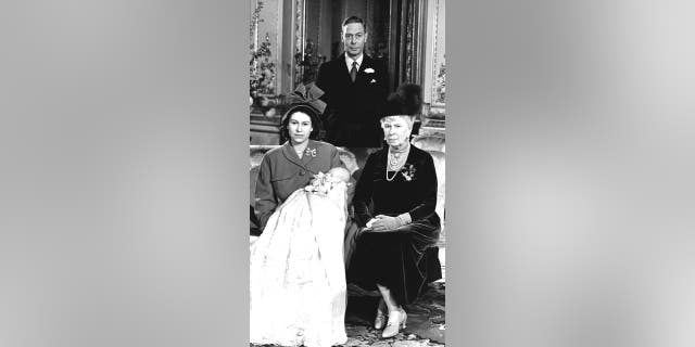 Queen Elizabeth pictured with her first son, Prince Charles, her grandmother Queen Mary and father King George VI at Buckingham Palace on the day of his Christening.