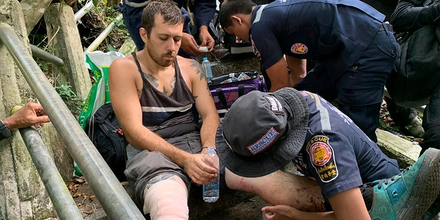 Grasser was treated for minor injuries after being rescued from the edge of a cliff. (Phatthalung Rescue Organization via AP)