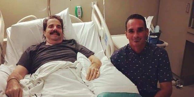 Jack Keith (right) visiting Tom Sovilla in the hospital.