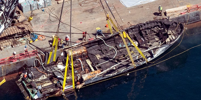 FILE - In this Sept. 12, 2019, file photo, the burned hull of the Conception is brought to the surface by a salvage team off Santa Cruz Island in the Santa Barbara Channel in Southern California. (Brian van der Brug/Los Angeles Times via AP, File)