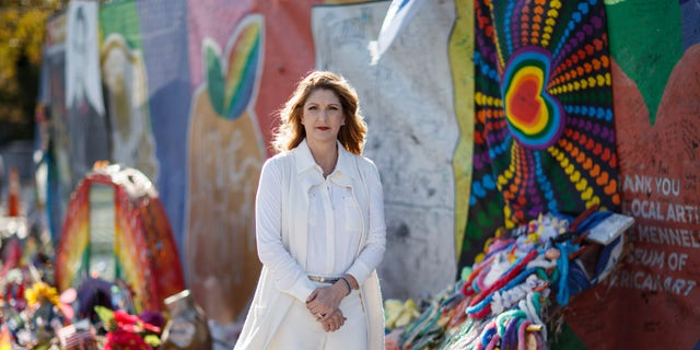 Barbara Poma, owner of the Pulse nightclub and Founder/CEO of the onePULSE Foundation standing in front of the Pulse Interim Memorial (onePULSE Foundation)