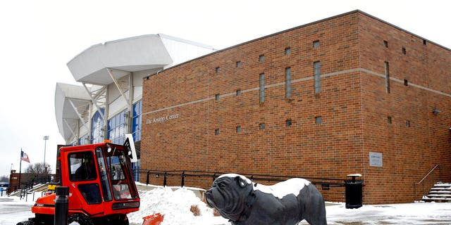 A statue depicting Drake University's bulldog mascot stands outside a university venue that will host a Democratic presidential primary as workers clear snow, Monday, Jan. 13, 2020, in Des Moines, Iowa. The debate is scheduled for Tuesday. (AP Photo/Patrick Semansky)