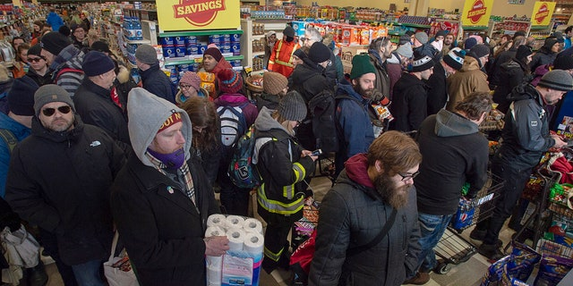 Customers fill a Sobeys grocery store in St. John's, Newfoundland, Tuesday, Jan. 21, 2020.