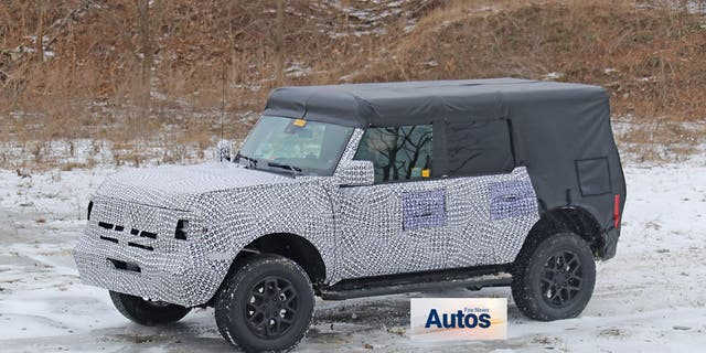 Spy photos of a camouflaged version of the all-new Bronco reveal its retro-inspired boxy shape.