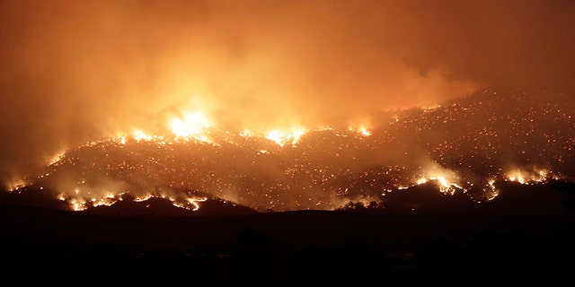 A blaze on Canberra's southern fringe that has razed more than 53,000 acres since it was sparked by heat from a military helicopter landing light on Monday, 관리들은 말한다.