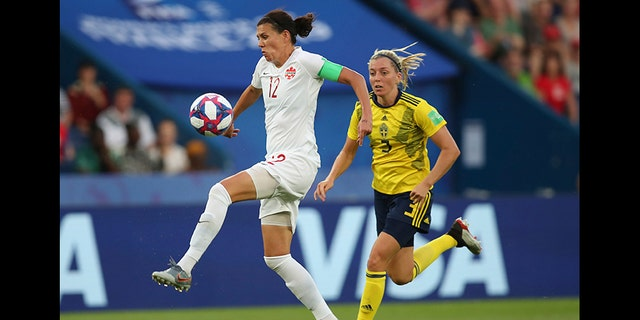 Canada's Christine Sinclair, left, is chased down by Sweden's Linda Sembrant during a Women's World Cup round of 16 soccer match in Paris, France, in June 2019.