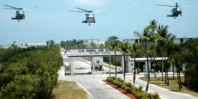 Two Chinese students were arrested over the weekend for allegedly taking photos inside theNaval Air Station Key West in Florida.