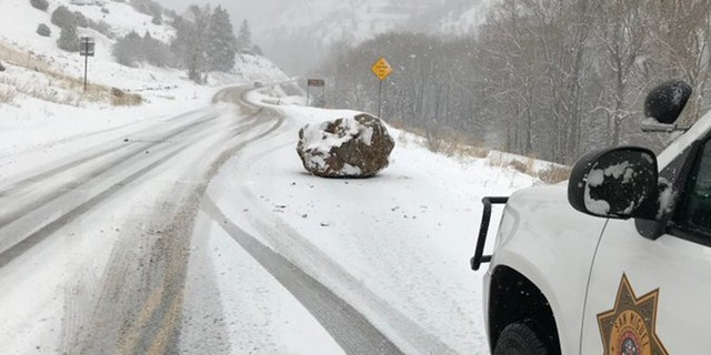 """The """"large boulder the size of a small boulder"""" fell on Colorado State Highway 145 outside Telluride on Monday afternoon."""