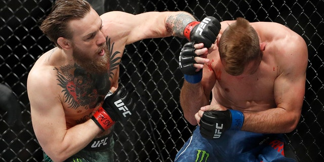 "Conor McGregor hits Donald ""Cowboy"" Cerrone during a UFC 246 welterweight mixed martial arts bout Saturday, Jan. 18, 2020, in Las Vegas. (Associated Press)"