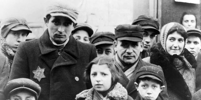 Jews wearing Star of David badges, Lodz Ghetto, Poland, World War II, 1940-1944. The Nazis forced Jews into over-crowded ghettos from which thousands were deported to the death camps. (Photo by Jewish Chronicle/Heritage Images/Getty Images)