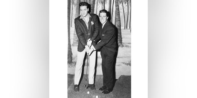 Elvis, seen here with Masters champion Gary Player, was not a big golfer.