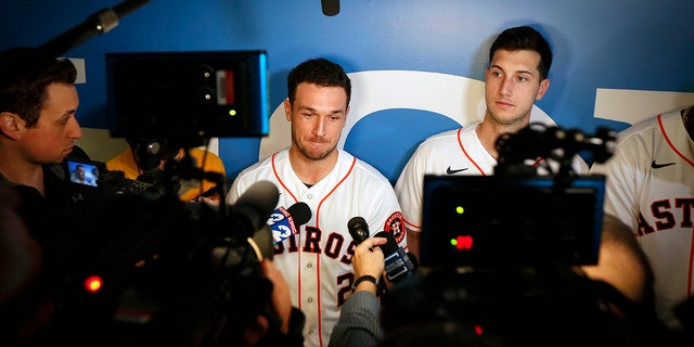 Houston Astros' Alex Bregman, center, is interviewed by the media during the baseball team's FanFest, Saturday, Jan. 18, 2020, in Houston. Astros' Kyle Tucker, right, looks on. (Associated Press)