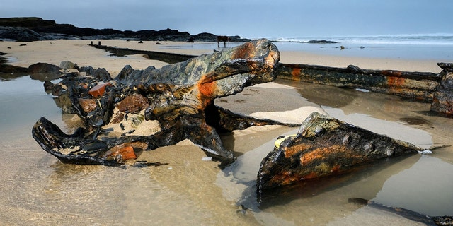 A First World War German shipwreck has been uncovered by recent storms at a Cornish beach more than a century after it became stranded on a reef while being towed by the Royal Navy. (Credit: SWNS)