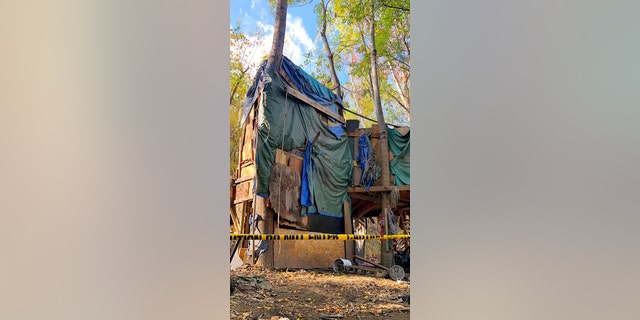 Cleanup crews tore down a massive three-story makeshift shelter built in the Sepulveda Basin on Thursday as cleanup crews entered the final phase of a four-part operation to rid the area of the many homeless encampments.