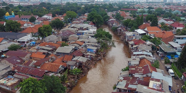 Residential buildings damaged by floods stand along the Ciliwung River in this aerial photograph taken in the Mangarai district of Jakarta, Indonesia, on Saturday, Jan. 4, 2020.
